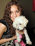 """Marlene Carles with Enrika at the """"Dog Days of Summer"""" Yappy Hour benefitting Citizens for Animal Protection and Golden Beginnings Golden Retriever Rescue at Hotel Derek Wednesday July 21,2010.(Dave Rossman/For the Chronicle)"""