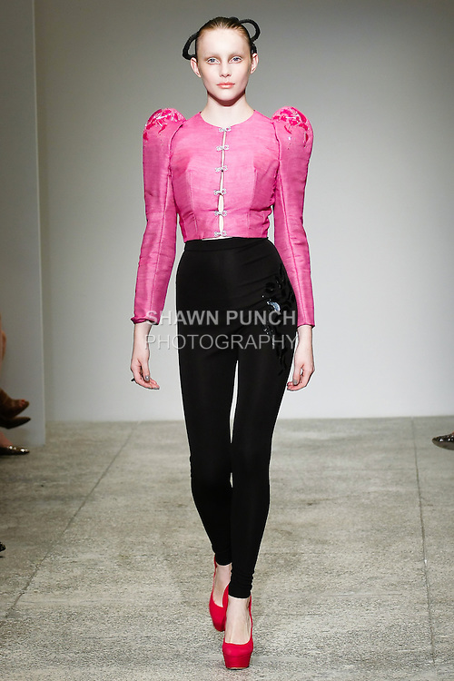 Model walks the runway in an outfit by Victor de Souza, during the Victor de Souza Spring 2011 fashion show, on September 8, 2010.