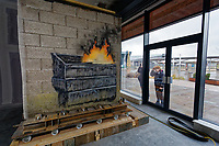 "Pictured: The Banksy at the Ty'r Orsaf building in Port Tabot, Wales, UK. Wednesday 18 December 2019 <br /> Re: A Banksy artwork will be on show to the public for the first time in its new location one year after it was created in Port Talbot, Wales, UK.<br /> The ""Season's Greetings"" mural appeared on the walls of steelworker Ian Lewis's garage last December.<br /> Gallery owner John Brandler paid a six-figure sum for the work, and agreed that it would stay in the town for three years.<br /> The piece will be on display at the Ty'r Orsaf building.<br /> In May, after months of planning, engineers used a crane to lift the 4.5 tonne mural on to a lorry, before it was escorted by police to its new home.<br /> The Welsh Government funded its transfer amid rising security costs."