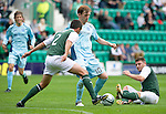 Hibs v St Johnstone...25.08.12   SPL.Liam Craig is tackled by Tim Clancy and.Picture by Graeme Hart..Copyright Perthshire Picture Agency.Tel: 01738 623350  Mobile: 07990 594431
