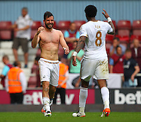 Jordi Amat of Swansea celebrates with Liroy Fer after the final whistle   during the Barclays Premier League match between West Ham United and Swansea City  played at Boleyn Ground , London on 7th May 2016