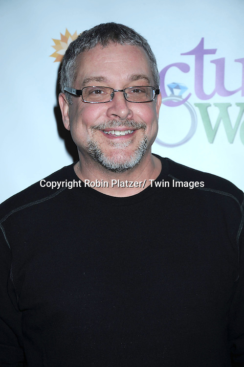 """director Michael Bush posing for photographers at the photo call .for """" Cactus Flower"""" on February 1, 2011 at The Westside Theatre Upstairs in New York City. The stars are Maxwell Caulfield, .Lois Robbins and Jenni Barber."""