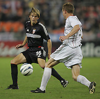 30 October,  2004.   DC United's Brian Carroll (16) tries to stop the progress of the MetroStars Chris Leitch (3) during the 2004 MLS playoffs at RFK Stadium in Washington, DC.