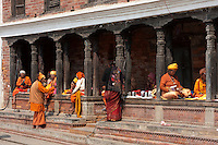 Pashupatinath, Nepal.  Sadhus, Hindu Ascetics or Holy Men and Women, Rest inside a Pati, an Open-Air Resting Place.