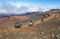Horseback riders on the Sliding Sands Trail at Haleakala National Park, Maui.