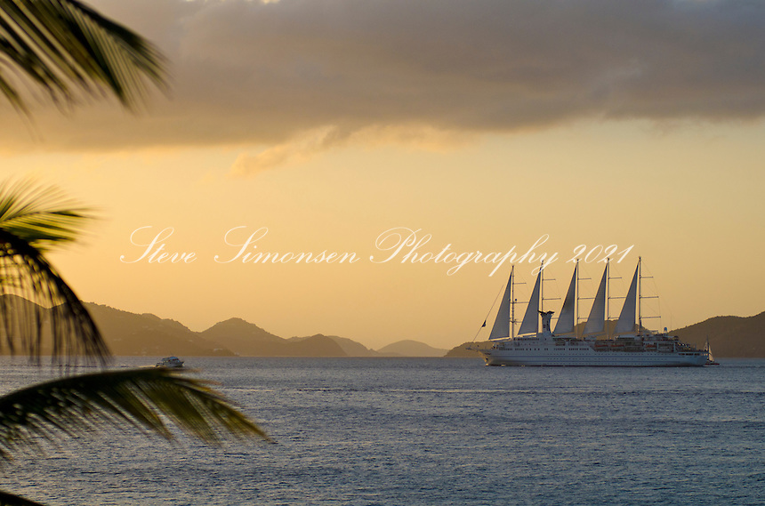 Club Med ll sails from St. John in the Pilsbury Sound at sunset<br /> U.S. Virgin Islands