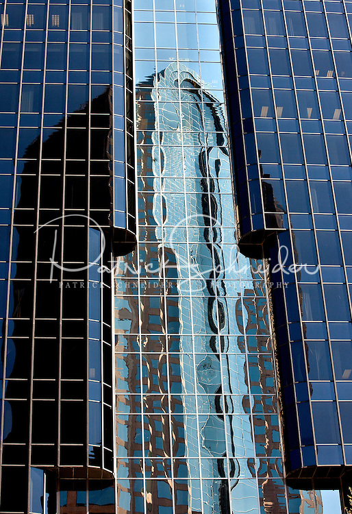 Street scenes in downtown Charlotte, NC. Here, the Wells Fargo tower reflects in the glass of a nearby tower.