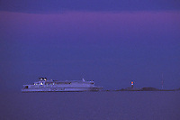 Silja Finnjet leaves Helsinki and passes Harmaja Lighthouse in the dying twilight of the Gulf of Finland
