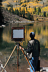 Photographer using a large-format view camera at Maroon Lake and the Maroon Bells Peaks, west of Aspen, Colorado, USA John offers fall foliage photo tours throughout Colorado.