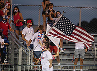The Greenwood High School student sectionmcelebrates a touchdown during Friday's football game against Springdale Har-Ber. Many students dressed in patriotic colors since the game was played on 9/11.