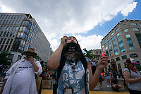 16 year old Alia Berry-Drobnich blows bubbles as demonstrators gather in support of Black Lives Matter near the White House in Washington D.C., U.S., on Tuesday, June 23, 2020.  Trump tweeted that he authorized the Federal government to arrest any demonstrator caught vandalizing U.S. monuments, with a punishment of up to 10 years in prison.  Credit: Stefani Reynolds / CNP/AdMedia