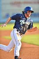 Asheville Tourists shortstop Ryan Vilade (4) rounds third base during a game against the Augusta GreenJackets at McCormick Field on August 18, 2018 in Asheville, North Carolina. The Tourists defeated the GreenJackets 14-3. (Tony Farlow/Four Seam Images)
