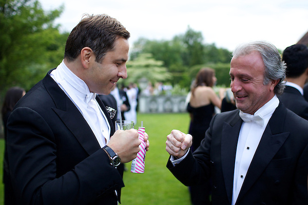 David Walliams and Raffy Manoukian bump fists at The Elton John White Tie and Tiara Ball