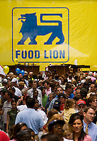 Crowds walk around during Food Lion Speed Street in uptown Charlotte, NC.