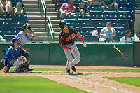 Lake Elsinore Storm Hudson Potts (15) follows through on his swing against the Rancho Cucamonga Quakes at LoanMart Field on May 28, 2018 in Rancho Cucamonga, California. The Storm defeated the Quakes 8-5.  (Donn Parris/Four Seam Images)