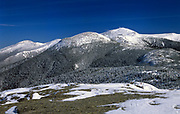 Mount Eisenhower (center); Mount Washington (behind right) and Mount Jefferson (left) from near the summit of Mount Pierce in the White Mountains, New Hampshire USA during the winter months.