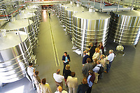 The brand new winery (cuverie) with stainless steel fermentation tanks, view from above, and a group of visitors on a wine tour - Chateau Belgrave, Haut-Medoc, Grand Crus Classe 1855