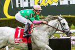 OCTOBER 6, 2018 : Disco Partner, ridden by Irad Ortiz Jr., wins the Belmont Turf Sprint Stakes on Champagne Stakes Day at Belmont Park on October 6, 2018 in Elmont, NY.  Sue Kawczynski/ESW/CSM