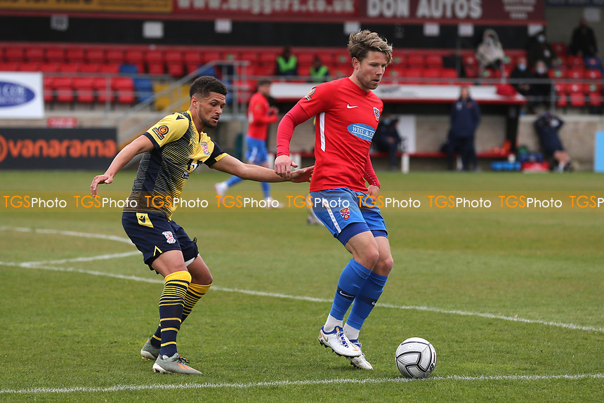 Callum Reynolds of Dagenham and Redbridge and Kane Ferdinand of Woking during Dagenham & Redbridge vs Woking, Vanarama National League Football at the Chigwell Construction Stadium on 3rd May 2021