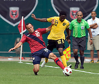 Landon Donovan (10) of the USMNT fights for the ball with Demar Phillips (12) of Jamaica at RFK Stadium in Washington, DC.  The USMNT defeated Jamaica, 2-0.