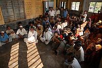 BANGLADESH, Khulna, village Kalabogi at Shibsha river, peoples in flood and cyclone shelter / BANGLADESCH, Division Khulna, Dorf Kalabogi am Fluss Shibsha , Dorfbewohner in einem Schutzhaus fuer  Flutkatastrophen und Wirbelstuerme