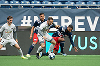 FOXBOROUGH, MA - APRIL 17: Emiliano Terzaghi #32 of Richmond Kickers tackels Christian Malfa #38 of New England Revolution II during a game between Richmond Kickers and Revolution II at Gillette Stadium on April 17, 2021 in Foxborough, Massachusetts.