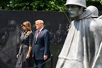 US President Donald J. Trump, alongside First Lady Melania Trump, tours the Korean War Veterans Memorial in Washington, DC, USA, 25 June 2020. On 24 June, in the wake of anti-racism protests aimed at monuments around the country, the president activated the National Guard to provide unarmed security for monuments in the nation's capital.<br /> Credit: Jim LoScalzo / Pool via CNP/AdMedia