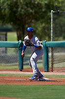 AZL Royals first baseman Felix Familia (7) prepares to catch a throw during an Arizona League game against the AZL Dodgers Lasorda on July 4, 2019 at Camelback Ranch in Glendale, Arizona. The AZL Royals defeated the AZL Dodgers Lasorda 4-1. (Zachary Lucy/Four Seam Images)