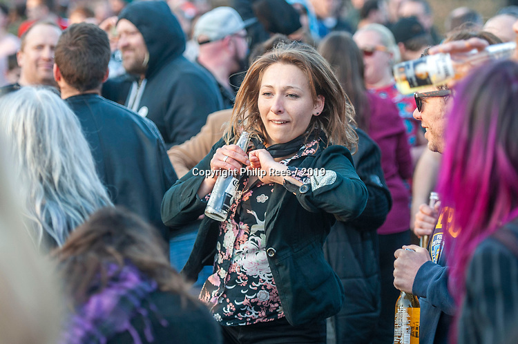 Prodigy fans take part in an impromptu rave on the main road after the  funeral of Prodigy singer Keith Flint at St Marys Church in Bocking,  Essex today.