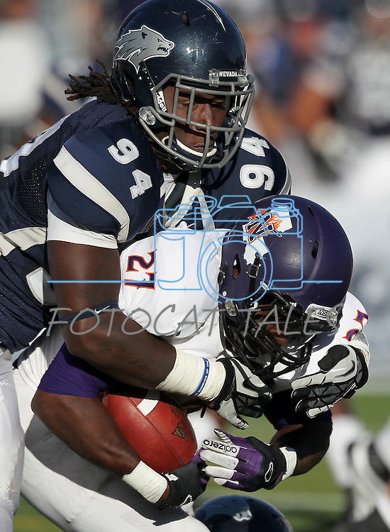 Northwestern State's Sidney Riley (27) is tackled by Nevada's Lenny Jones (94) during the first half of an NCAA college football game Saturday, Sept. 15, 2012, in Reno, Nev. (AP Photo/Cathleen Allison)