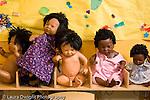 Educaton preschool row of dolls in pretend play area still life horizontal
