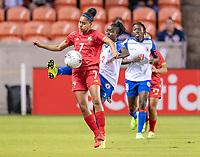 HOUSTON, TX - FEBRUARY 3: Maria Guevara #7 of Panama is defended by Soveline Beaubrun #2 of Haiti during a game between Panama and Haiti at BBVA Stadium on February 3, 2020 in Houston, Texas.
