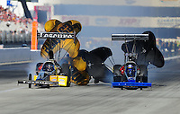 Nov. 11, 2011; Pomona, CA, USA; NHRA top fuel dragster driver Mike Ashley (left) crosses over the center line alongside Pat Dakin during qualifying at the Auto Club Finals at Auto Club Raceway at Pomona. Mandatory Credit: Mark J. Rebilas-.
