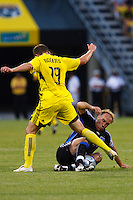 27 MAY 2009: #19 Robbie Rogers, Columbus Crew forward and Simon Elliot of the San Jose Earthquakes in action during the San Jose Earthquakes at Columbus Crew MLS game in Columbus, Ohio on May 27, 2009. The Columbus Crew defeated San Jose 2-1