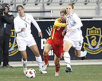 Lindsay Tarpley #5 of the USA WNT tries to get away from Fan Yu #3 of the PRC WNT during an international friendly match at PPL Park, on October 6 2010 in Chester, PA. The game ended in a 1-1 tie.