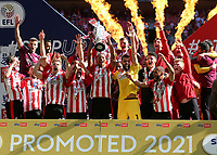 David Raya lifts the Championship Trophy aloft as Brentford celebrate promotion to the Premier League during Brentford vs Swansea City, Sky Bet EFL Championship Play-Off Final Football at Wembley Stadium on 29th May 2021