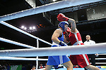 Glasgow 2014 Commonwealth Games<br /> <br /> Lauren Price, Wales (Blue) v Ariane Fortin, Canada (Red)<br /> <br /> 01.08.14<br /> ©Steve Pope-SPORTINGWALES