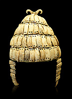 """Boar's tusk helmet with cheek guards and double bone hook on top. Tomb 515 Mycenae, Greece. 14th-15th century BC. National Archaeological Museum, Athens.. The Boar's tusk helmet was described in the Iliad as follows """"Meriones gave Odysseus a bow, a quiver and a sword, and put a cleverly made leather helmet on his head. On the inside there was a strong lining on interwoven straps, onto which a felt cap had been sewn in. The outside was cleverly adorned all around with rows of white tusks from a shiny-toothed boar, the tusks running in alternate directions in each row.<br /> —Homer, Iliad 10.260–5"""""""
