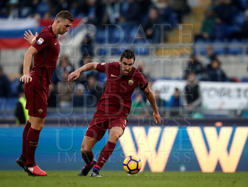 Calcio, Serie A: Lazio vs Roma. Roma, stadio Olimpico, 4 dicembre 2016.<br /> Roma's Kevin Strootman, right, flanked by his teammate Edin Dzeko, in action during the Italian Serie A football match between Lazio and Rome at Rome's Olympic stadium, 4 December 2016. Roma won 2-0.<br /> UPDATE IMAGES PRESS/Isabella Bonotto