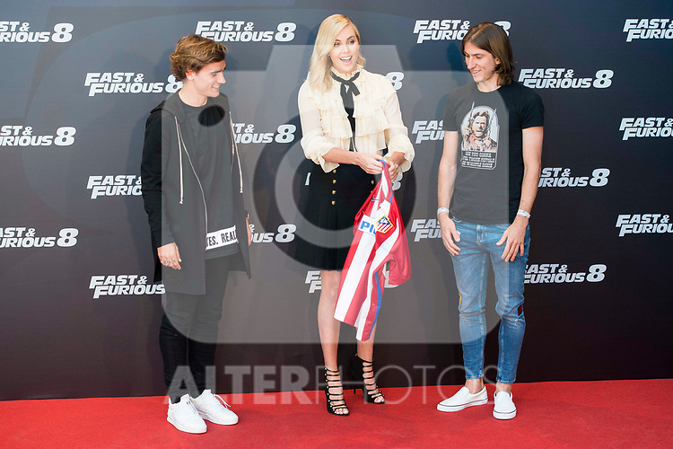 """South African actress Charlize Theron with Atletico de Madrid's player Antoine Griezmann (L) and Filipe Luis (R) during the presentation of the film """"Fast & Furious 8"""" at Hotel Villa Magna in Madrid, April 06, 2017. Spain.<br /> (ALTERPHOTOS/BorjaB.Hojas)"""