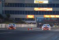 May 18, 2012; Topeka, KS, USA: NHRA pro stock driver Greg Anderson (right) races alongside teammate Jason Line during qualifying for the Summer Nationals at Heartland Park Topeka. Mandatory Credit: Mark J. Rebilas-