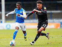 1st May 2021; Weston Homes Stadium, Peterborough, Cambridgeshire, England; English Football League One Football, Peterborough United versus Lincoln City; Siriki Dembele of Peterborough United takes on Morgan Rogers of Lincoln City
