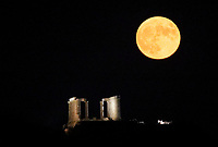 2019 08 15 The full moon rises over the ancient Temple of Poseidon in Sounion, Greece