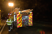 Firefighters making up after an incident on the motorway. This image may only be used to portray the subject in a positive manner..©shoutpictures.com..john@shoutpictures.com