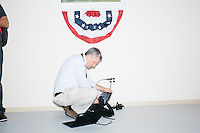A journalist readies his equipment before Texas senator and Republican presidential candidate Ted Cruz speaks to a crowd at the kick-off event at his New Hampshire campaign headquarters in Manchester, New Hampshire.