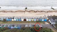 BNPS.co.uk (01202) 558833. <br /> Pic: BNPS<br /> <br /> Pictured: The beach hut, circled, at Friars Cliff.<br /> <br /> A beach hut that looks more like a garden shed you could buy from B&Q for £500 has gone the market - for almost £60,000.<br /> <br /> At 7ft by 8ft the timber cabin is about the same size as most garden sheds, but its idyllic location makes it far more valuable.<br /> <br /> Hut 128 is on Friars Cliff Beach in Christchurch, Dorset.<br /> <br /> The dilapidated hut is about 30 years old and in need of replacing. It doesn't have any fixtures or fittings and is just an empty shell.