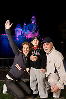 "Céline Dion (L), son René-Charles, 6, and husband René Angélil outside Sleeping Beauty Castle at Disneyland in Anaheim, Calif. last week.  Dion and her family, are taking a short break from her smash Las Vegas show ""A New Day"", currently in its last year at Caesar's Palace. (CNW Group/Walt Disney Company Parks & Resorts)"