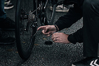 extra greasing the chain ahead of a wet/muddy race at the race start in Compiègne<br /> <br /> 118th Paris-Roubaix 2021 (1.UWT)<br /> One day race from Compiègne to Roubaix (FRA) (257.7km)<br /> <br /> ©kramon