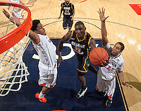 CHARLOTTESVILLE, VA- DECEMBER 6: Vertrail Vaughns #11 of the George Mason Patriots shoots between Jontel Evans #1 of the Virginia Cavaliers and Malcolm Brogdon #22 of the Virginia Cavaliers during the game on December 6, 2011 at the John Paul Jones Arena in Charlottesville, Virginia. Virginia defeated George Mason 68-48. (Photo by Andrew Shurtleff/Getty Images) *** Local Caption *** Jontel Evans;Malcolm Brogdon;Vertrail Vaughns