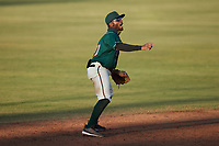 Greensboro Grasshoppers shortstop Liover Peguero (10) on defense against the Hickory Crawdads at First National Bank Field on May 6, 2021 in Greensboro, North Carolina. (Brian Westerholt/Four Seam Images)